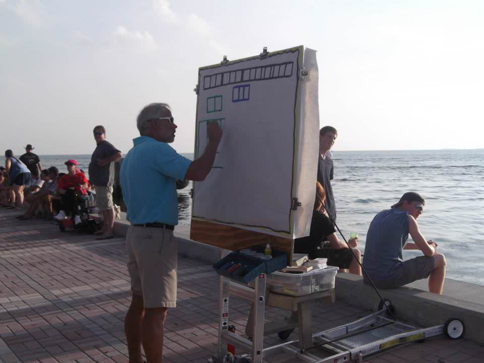 Bill Welzien prepares his presentation at Mallory Square in Key West