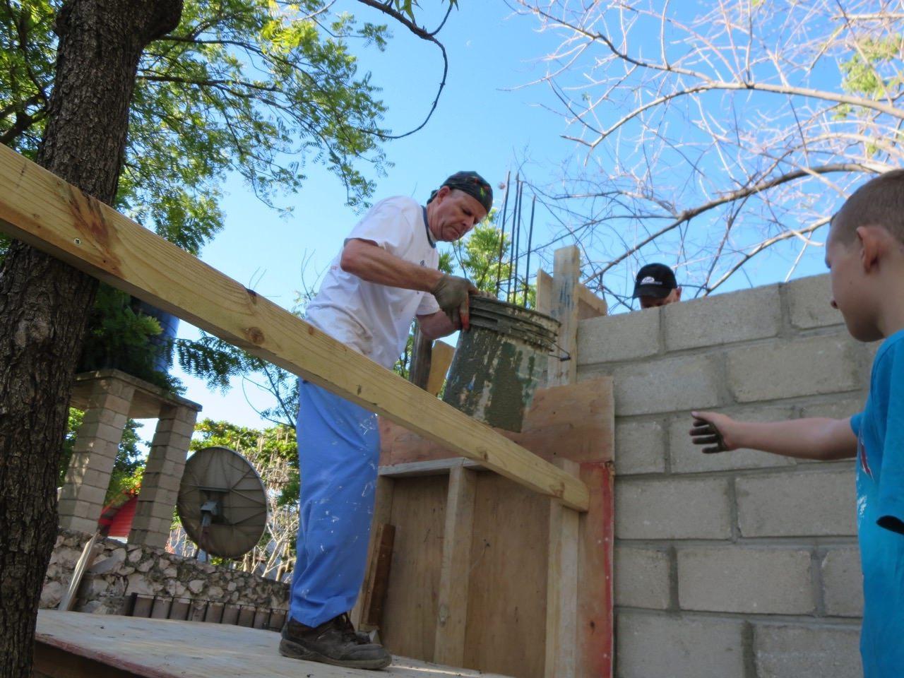 2014 Haiti wall - men at work
